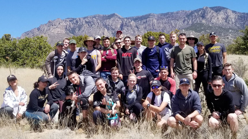 Group shot of Army ROTC in front of Sandia Mountains